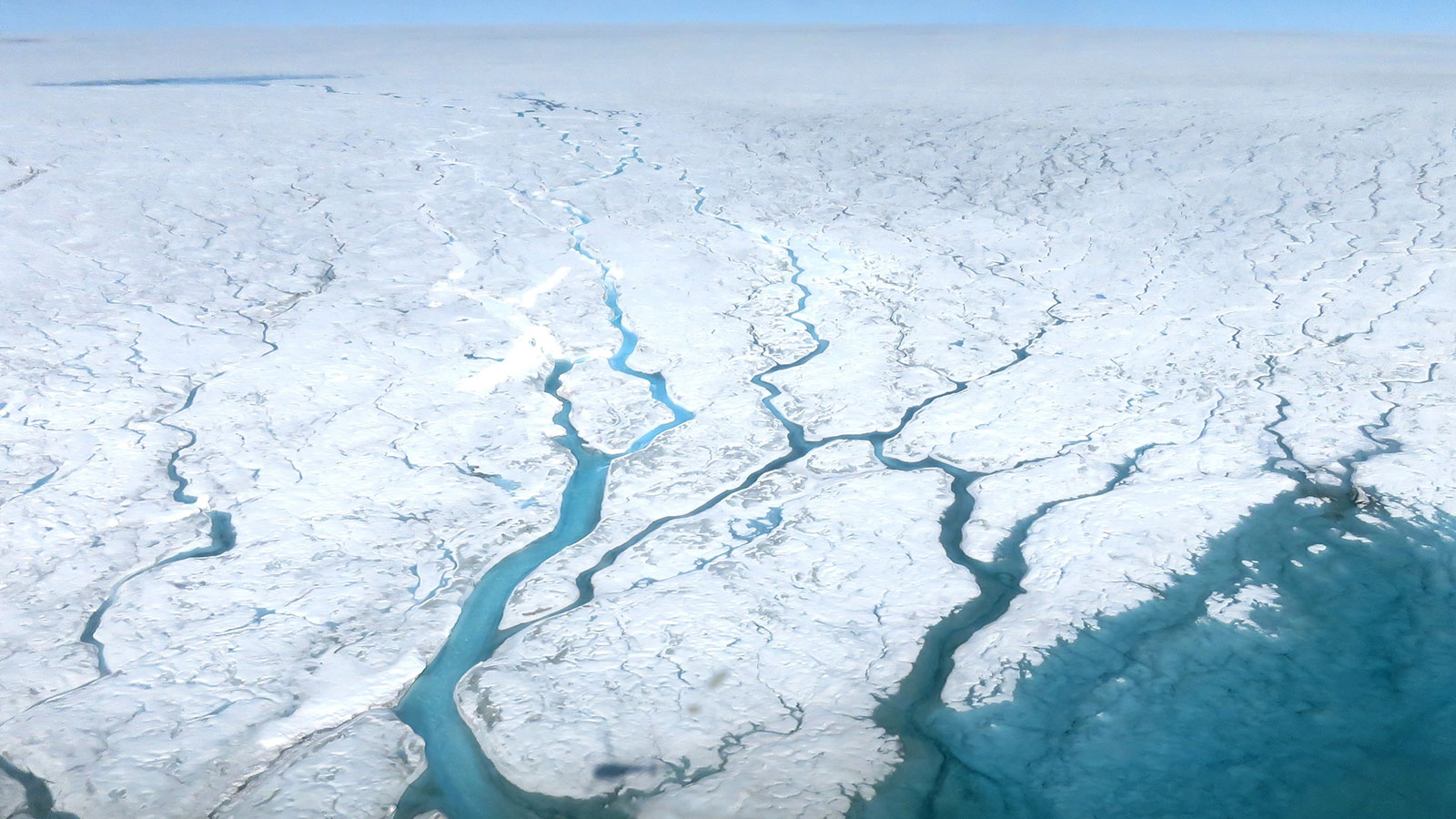 slide 1 - Aerial photograph of meltwater rivers over the Greenland Ice Sheet