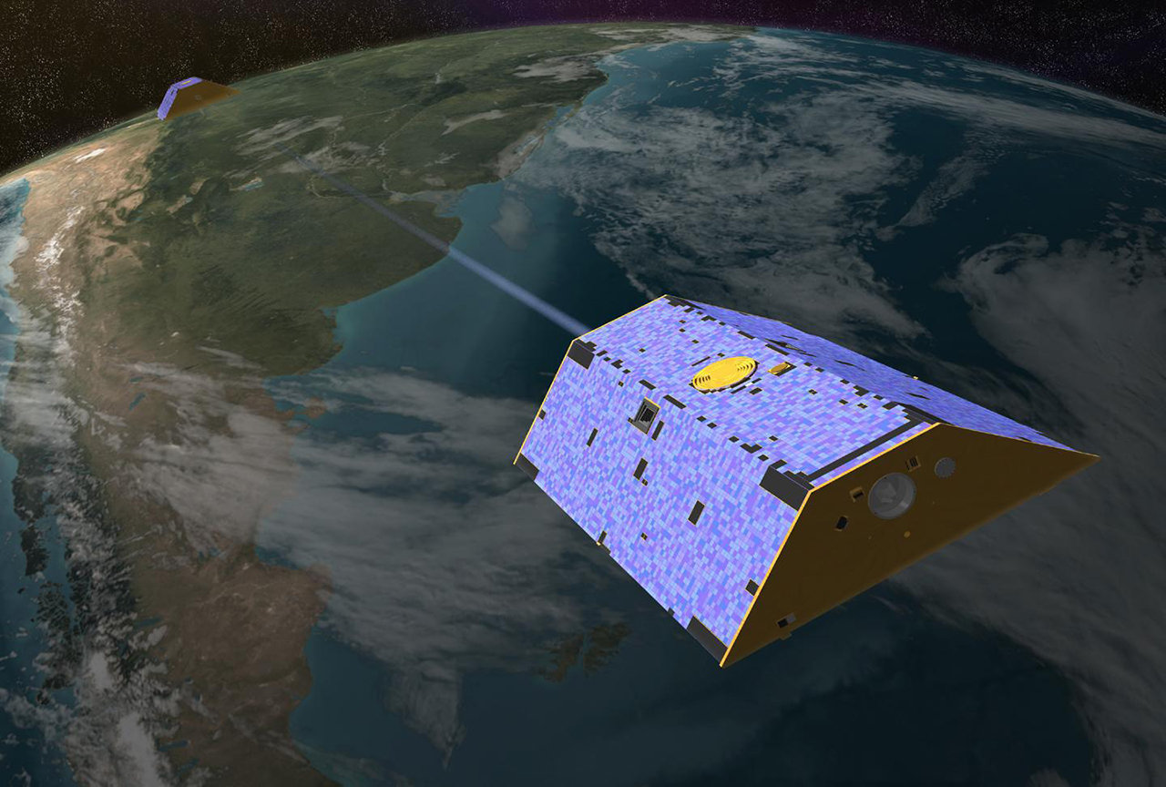 Artist's rendering of the twin Gravity Recovery and Climate Experiment (GRACE) satellites in orbit over Earth.