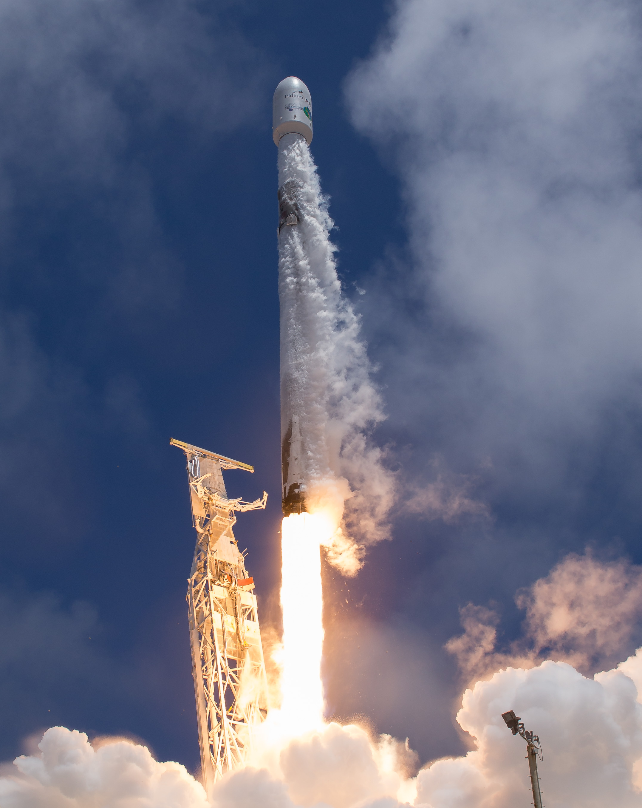 A vertical image of the rocket launching in front of a blue sky.